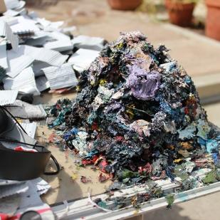 A paint mound behind Nicks' studio